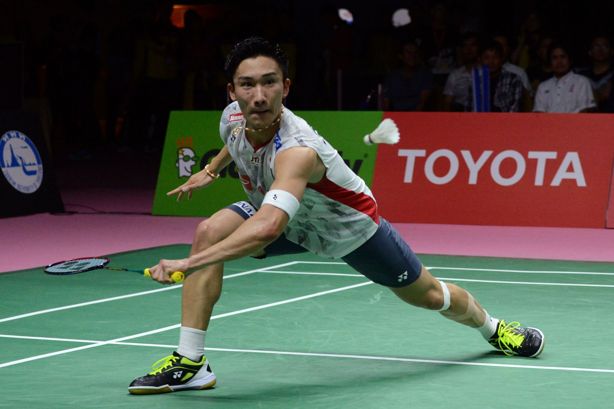 Japan's Kento Momota hits a shot during Friday's Thomas Cup semifinal against Denmark. | AFP-JIJI