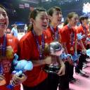 Japan team captain Ayaka Takahashi holds the trophy as she and her teammates celebrate winning the Uber Cup on Saturday in Bangkok.
