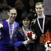 Runner-up Jason Brown (left), seen with winner Shoma Uno (center) and third-place finisher Alexander Samarin at the 2017 Skate Canada International, is switching coaches to work under  Brian Orser. | CC-BY-SA 3.0