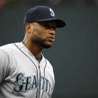 Seattle's Robinson Cano walks on the field before an Aug. 28, 2017, game against the Orioles in Baltimore. | AP