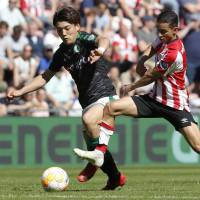 Groningen midfielder Ritsu Doan (left),  seen in action in a recent Dutch League first-division match, will complete a full transfer to the team from Gamba Osaka.   KYODO
