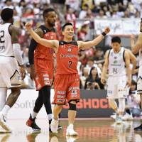 Chiba's Yuki Togashi (2) celebrates after the Jets' 72-64 win over the Golden Kings in Game 2 of their B. League Championship semifinal series on Sunday in Funabashi, Chiba Prefecture. | KYODO