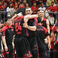 Alvark coach Luka Pavicevic, seen embracing team leader Daiki Tanaka on Saturday, guided the club to a B. League title in his first season at the helm. | YOSHIAKI MIURA