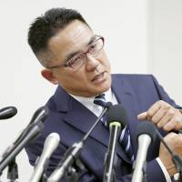 Yasutoshi Okuno holds a news conference in Osaka on Tuesday, speaking about a dirty hit by Nihon University defensive end Taisuke Miyagawa in a May 6 game that injured his son, a Kwansei Gakuin University quarterback. | KYODO