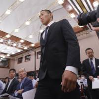Taisuke Miyagawa, a Nihon University American football player, arrives for a news conference on Tuesday in Tokyo. | AP