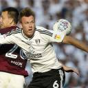 Fulham's Kevin McDonald (right) vies with Aston Villa's John Terry during the playoff final on Saturday at Wembley.