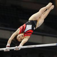 Mai Murakami participates in the women's all-around competition during the NHK Cup on Saturday at Tokyo Metropolitan Gymnasium. She finished first overall. | KYODO