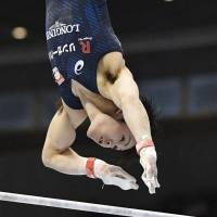 Kohei Uchimura performs at the NHK Cup on Sunday. | KYODO
