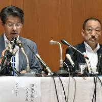 Kwansei Gakuin University director Hiromu Ono (left) addresses the media during a news conference on Thursday in Osaka. | KYODO