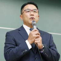 Yasutoshi Okuno, the father of the Kwansei Gakuin University quarterback who was injured by a dirty tackle, speaks at a news conference on Saturday. | KYODO