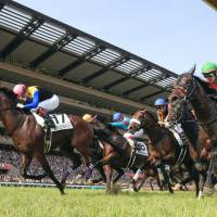 Yuichi Fukunaga (left) comes home to win the Japanese Derby atop Wagnerian on Sunday at Tokyo Racecourse. | KYODO