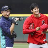 The Mariners' Ichiro Suzuki shares a laugh with the Angels' Shohei Ohtani before their game on Friday in Seattle. | KYODO