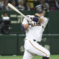 The Giants' Shinnosuke Abe belts a three-run home run in the third inning against the Tigers at Tokyo Dome on Thursday night. Yomiuri defeated Hanshin 4-2. | KYODO