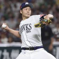 Hawks right-hander Shota Takeda pitches against the Buffaloes on Saturday at Yafuoku Dome. Takeda tossed a one-hit shutout as Fukuoka SoftBank topped Orix 3-0. | KYODO