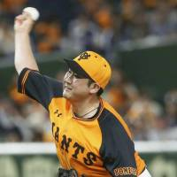 Giants ace Tomoyuki Sugano delivers a pitch on Friday against the Dragons at Tokyo Dome. Sugano tossed a five-hit shutout as Yomiuri downed Chunichi 6-0. | KYODO