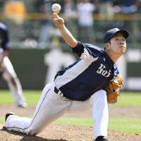 Lions hurler Shinsaburo Tawata fires a pitch during Saturday's game against the Buffaloes at Hotto Motto Field. Seibu blanked Orix 7-0. | KYODO