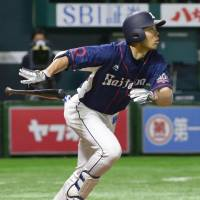 The Lions' Shogo Akiyama belts a three-run home run in the sixth inning against the Hawks at Yafuoku Dome on Thursday. Seibu defeated Fukuoka SoftBank 12-5. | KYODO