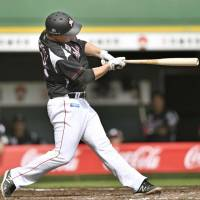 Chiba Lotte's Matt Dominguez hits a two-run home run in the fifth inning of the Marines' 6-3 win over the Buffaloes on Saturday.   KYODO