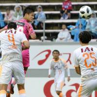 Sagan Tosu's Yuji Ono (second left) scores during his team's 3-1 win over Shimizu S-Pulse in the J. League on Sunday. | KYODO