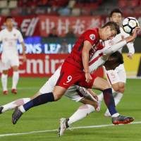 Antlers' Yuma Suzuki (9) scores on a header during Kashima's victory over Shanghai in their Asian Champions League match on Wednesday in Kashima, Ibaraki Prefecture. | KYODO