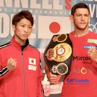 Naoya Inoue (left) and WBA bantamweight champion Jamie McDonnell pose for a photo Wednesday ahead of their title fight in Tokyo on Friday. | KAZ NAGATSUKA