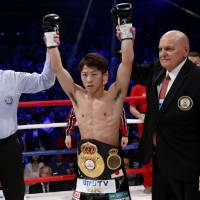 Naoya Inoue celebrates his victory over WBA bantamweight champion Jamie McDonnell on Friday night at Ota City General Gymnasium. | AP