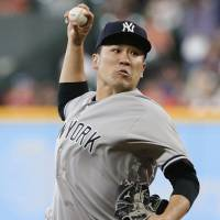 New York starter Masahiro Tanaka pitches against Houston in the first inning on Thursday. | AP