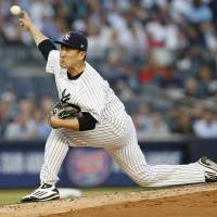 Streaking Yankees rally past Red Sox