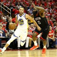 Golden State's Stephen Curry drives on Houston's James Harden in the third quarter of Game 1 on Monday. | USA TODAY / VIA REUTERS