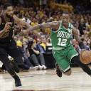 Boston's Terry Rozier drives on Cleveland's Tristan Thompson in the second half of Game 4 on Monday night.