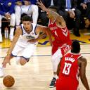 Warriors guard Klay Thompson tries to drive around the Rockets' Gerald Green during the first quarter on Saturday in Oakland, California.