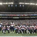 "Houston Texans players kneel and stand during the singing of the national anthem before an NFL football game against the Seattle Seahawks, in Seattle last October. NFL owners have approved a new policy aimed at addressing the firestorm over national anthem protests, permitting players to stay in the locker room during the ""The Star-Spangled Banner"" but requiring them to stand if they come to the field. The decision was announced Wednesday by NFL Commissioner Roger Goodell during the league's spring meeting in Atlanta."