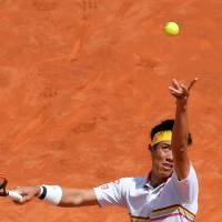 Kei Nishikori serves during his first-round match against Spain's Feliciano Lopez at the Italian Open in Rome on Monday. | AFP-JIJI