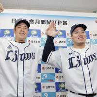 Seibu Lions pitcher Shinsaburo Tawata and infielder Hotaka Yamakawa pose for photos during a news conference after being named the Pacific League's monthly MVPs for games played during the March-April period. | KYODO