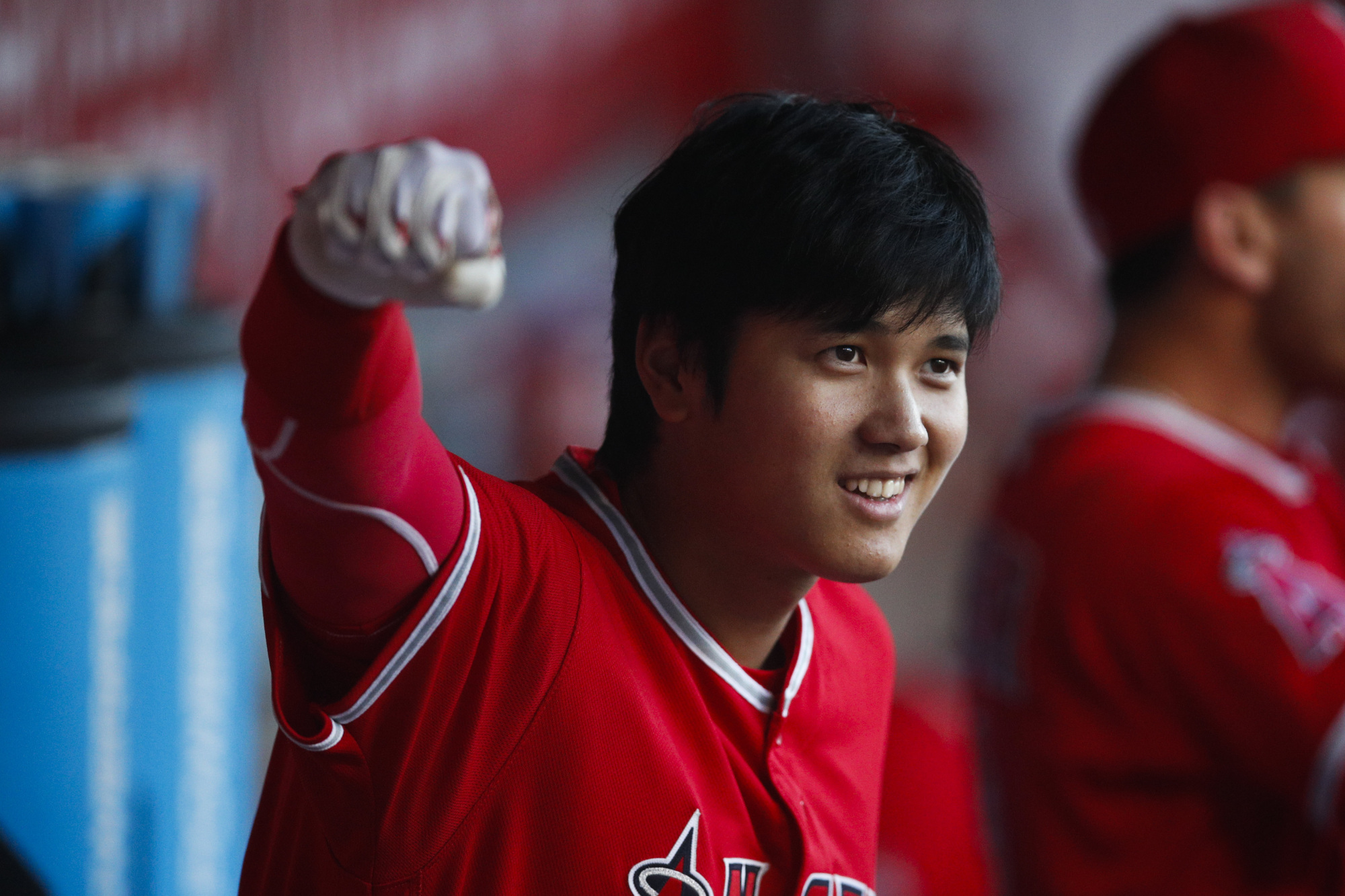 Shohei Ohtani gestures from the dugout during the first inning of the Angels' game against the Astros on Tuesday in Anaheim, California. | AP