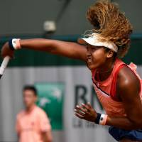 Naomi Osaka hits a shot during her first-round win over Sofia Kenin of the United States at the French Open on Monday. | AFP-JIJI
