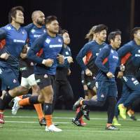 The Brave Blossoms run during a morning practice on Nov. 25, 2017, ahead of a match against France in Paris. | KYODO