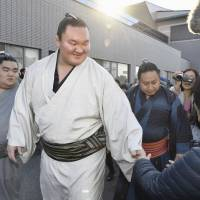 Under current eligibility rules, yokozuna Hakuho would be excluded from playing any role in sumo if he were to retire today. | KYODO