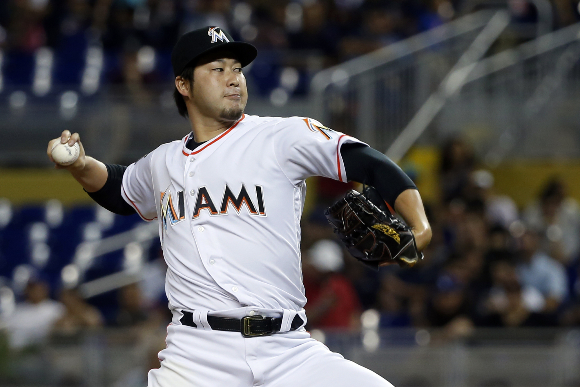 Miami's Junichi Tazawa pitches during the Marlins' game against the Dodgers on May 17. | AP