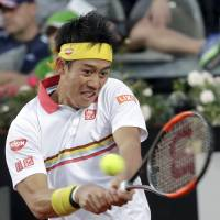 Kei Nishikori plays a shot from Germany's Philipp Kohlschreiber in their third-round match at the Italian Open on Thursday. | AP
