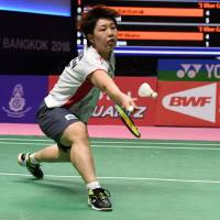 Japan's Akane Yamaguchi hits a return to SouthKorea's Sung Ji-hyun in the women's singles semifinals match at the Uber Cup in Bangkok on Friday. | AFP-JIJI