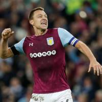 Aston Villa captain John Terry celebrates after his team's Championship playoff semifinal aggregate victory over Middlesbrough on Tuesday. | REUTERS