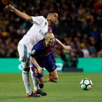 Barcelona's Andres Iniesta (front) is reportedly set to accept a three-year deal to play for Vissel Kobe.   REUTERS