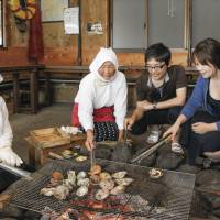 Ama divers serve seafood to visitors in amagoya (ama huts) in Toba, Mie Prefecture, which is home to about half of ama in Japan. MIE PREFECTURE