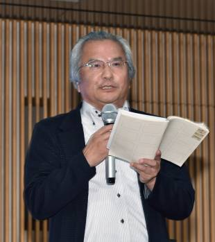 Masataka Ota, chief consultant at JTB Tourism Research & Consulting Co. who serves as a vice-chairman of the Japan Times Satoyama Consortium management committee, addresses the audience at the symposium