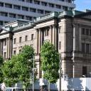 The Bank of Japan stands in central Tokyo. Sources say the BOJ may lower its inflation forecast for the current fiscal year, acknowledging that price gains have undershot expectations.