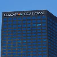 The Comcast NBC Universal logo is shown on a building in Los Angeles Wednesday. | REUTERS