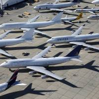 Planes sit in a desert graveyard near Victorville, California, on March 28. Strong e-commerce demand is lifting the air freight business. | REUTERS
