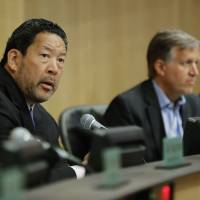 Seattle City Council President Bruce Harrell (left) speaks Tuesday during a council meeting at City Hall in Seattle.   AP