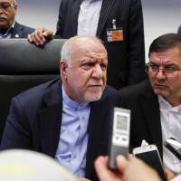 Iranian Oil Minister Bijan Namdar Zanganeh (left) speaks to reporters ahead of the OPEC meeting in Vienna on Friday. | BLOOMBERG